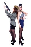 Two women in the military uniform with a guns Stock Photo