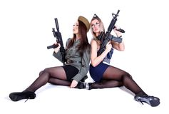 Two women in the military uniform with guns Royalty Free Stock Photos