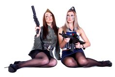 Two women in the military uniform with guns Stock Images