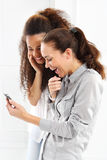 Two women with mobile phone Stock Photos