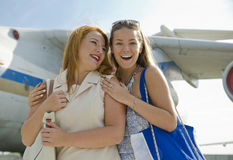 Two women mother and daughter met at the airport after trip Royalty Free Stock Images