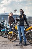 Two women motorcyclists making photo with selfie stick and front camera of cellular Stock Photo