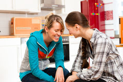 Two women with moving box in her house Royalty Free Stock Images