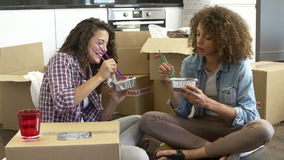 Two Women Moving Into New Home Enjoying Takeaway Meal stock video