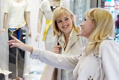 Two women near a show-window of shop Stock Photography