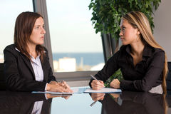 Two women negotiating Stock Photo