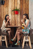 Two women in a night out drinking cocktails Stock Image