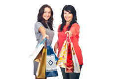 Two women offering shopping bags Royalty Free Stock Image