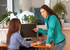 Two women  in office. Two women works in office Stock Images