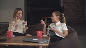 Two  women office workers eating dessert. At the business meeting stock video