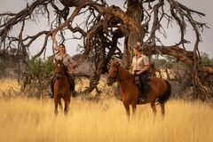 Free Two Women On Horseback By Dead Tree Stock Photography - 211055422