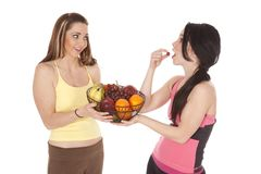 Two women one eating grape Stock Photo