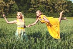 Two women, one levitates. Royalty Free Stock Photo