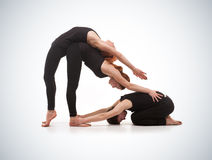 Two women and one men practicing yoga Royalty Free Stock Image