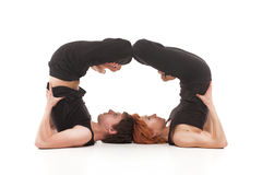 Two women and one men practicing yoga Stock Photos