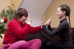 Two women making rhythm exercises royalty free stock images