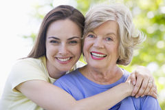Two women outdoors smiling Stock Photography