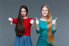 Two women over gray Royalty Free Stock Image