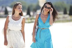 Two women over street background Royalty Free Stock Image