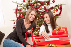 Two women packing Christmas present Royalty Free Stock Image