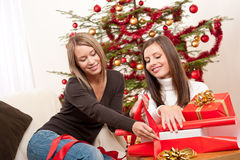 Two women packing Christmas present Stock Photos