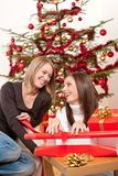 Two women packing Christmas present Royalty Free Stock Photography