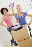 Two women with paint swatches in new home Stock Image