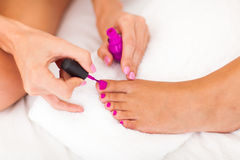 Painting toe polish. Two women painting toe polish Royalty Free Stock Photos