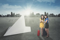 Two women with paper plane Stock Photos