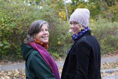 Two women in a park Stock Photos