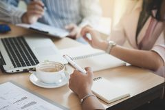 Two women participate business meeting. Abstract scene of businesswoman hand writing a note while participate in business meeting at office with argument stock photos