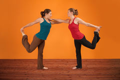 Two Women Perform Yoga Stock Photos
