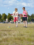 Two women and petanque game Royalty Free Stock Photo