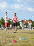 Two women and petanque game Stock Images