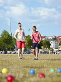 Two women and petanque game Royalty Free Stock Images