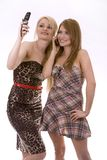 Two women on the phone. Two pretty woman on white isolated background talking on the phone Stock Photos