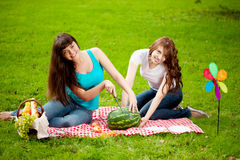 Two women on a picnic with watermelon Stock Photo