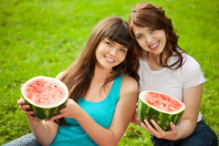 Two women on a picnic with watermelon Stock Photography
