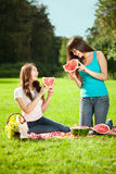 Two women on a picnic with watermelon Royalty Free Stock Photography