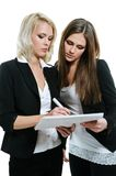 Two women planning. Two young business women planning royalty free stock images