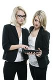 Two women planning. Two young business women planning royalty free stock photography