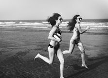 Two Women Play Beach Concept Royalty Free Stock Photo