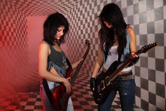 Two women play electric guitar in studio Royalty Free Stock Image