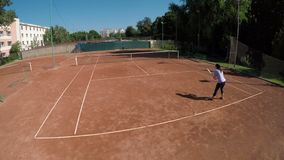 Point of view of two women play tennis outdoors at tennis arena. Two women play tennis outdoors at tennis arena stock video footage