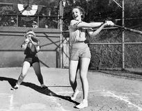 Two women playing baseball Royalty Free Stock Image