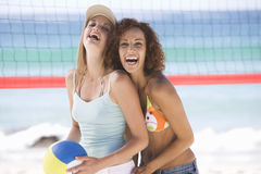 Two women playing beach volleyball Royalty Free Stock Photo