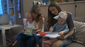 Two women playing with children stock video footage