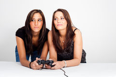 Two women, playing video games. Two women playing video games Stock Image