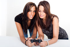 Two women, playing video games. Two women playing video games Royalty Free Stock Image