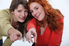 Two women pointing Royalty Free Stock Photography